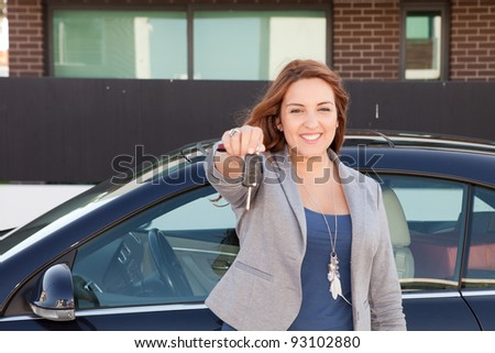 Business woman holding car key