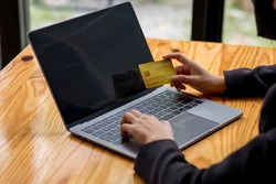 Business woman holding credit card and typing on the laptop for online shopping and payment makes a purchase on the Internet, Online payment, Business financial and technology.