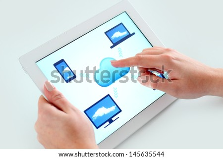 Business woman holding digital tablet computer with cloud computing theme on the screen and touching - stock photo