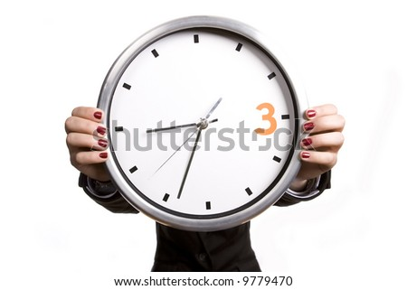 business woman holding giant alarm clock