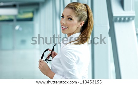 business woman holding glasses and looking at camera. Copy space