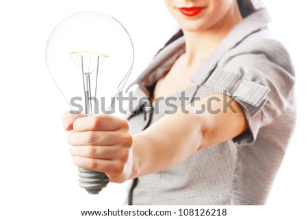 Business woman holding light bulb in hand