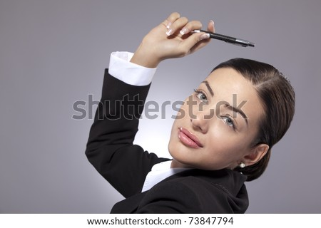 Business woman holding pencil