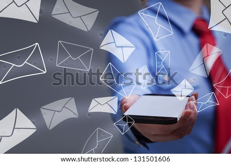 Business woman holding smartphone sending mail - with copy space on the phone