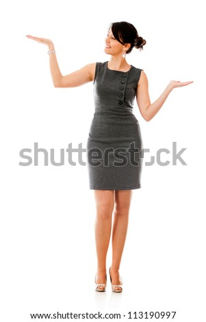 Business woman holding something in her hand - isolated over white background