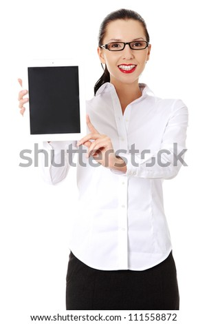 Business woman holding tablet PC with touch pad. Isolated on white