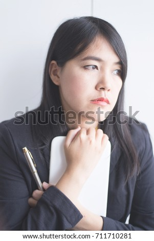 Business woman holding tablets and thinking new ideas for new business project plan