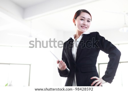 business woman holding with pad - stock photo