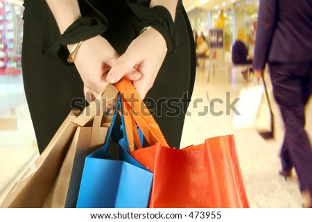 business woman in a shopping centre with some bags