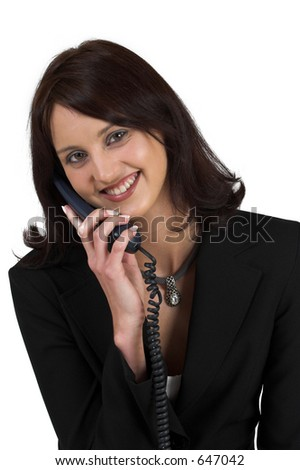 Business woman in formal black suit, holding phone, smiling