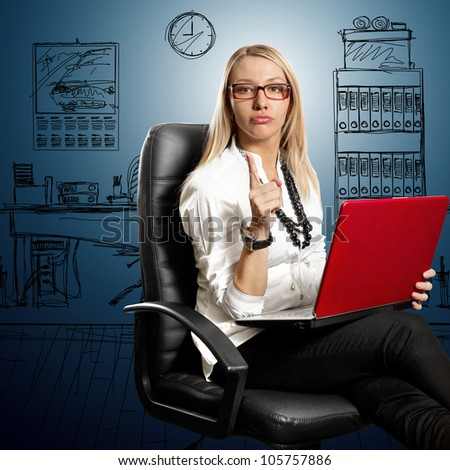 Business woman in leather chair, looking on camera
