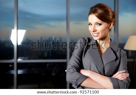 business woman in modern glass interior