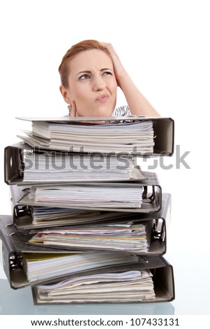 business woman in office looks at unbelievable folder stack isolated on white