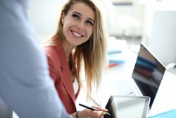 Business woman in office puts an electronic signature on tablet. Development and support of small and medium business concept