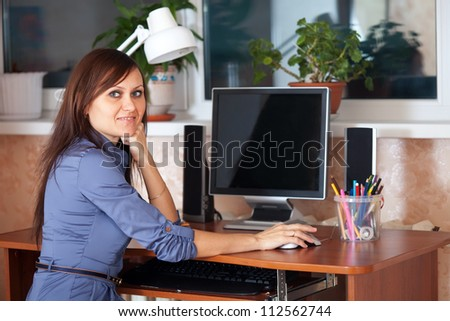 business woman in office using computer