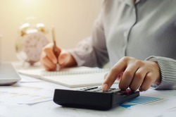business woman in tax deduction planning concept Calculate tax deduction in 2022, businessman calculates business balance, prepares for tax deduction.