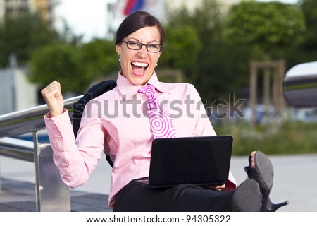 Business woman in the tie suit with notebook computer