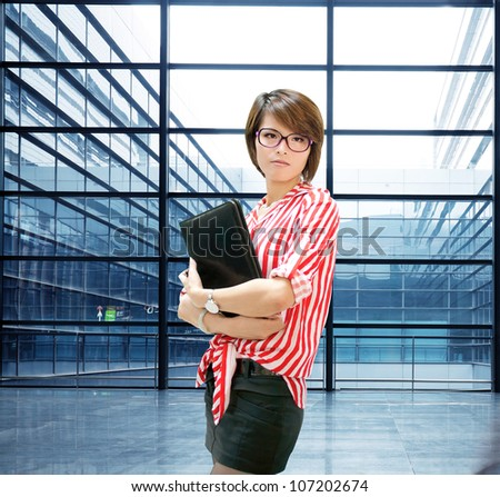 Business woman indoor, closeup portrait of Asian inside building of office