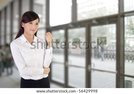 Business woman indoor, closeup portrait of Asian inside building of office.