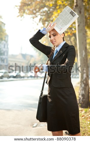 business woman is late for work or a meeting, looking in watch