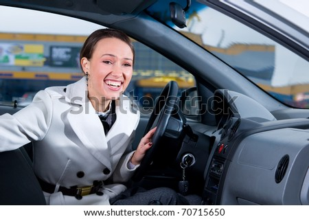 business woman is laughing in her car