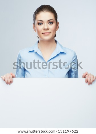Business woman isolated portrait . Smiling woman show  big blank board . Close up female face portrait with arms on blank card. Emotion face .
