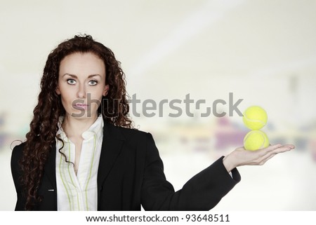 business woman juggling balls