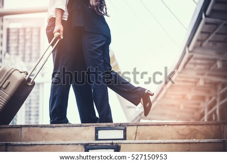 business woman Jump embracing her husband after bonding from business trip at city. Young couple worker. Young businessman in city. #527150953
