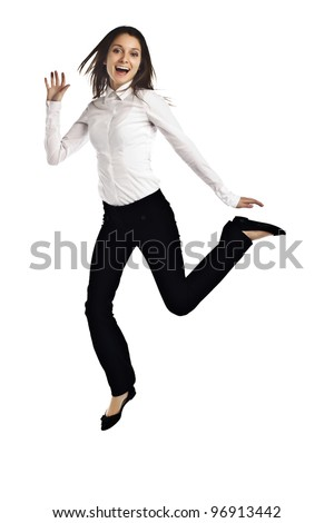 Business woman jumping for joy on white background