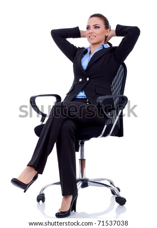 business woman leaning back in a black chair dreaming