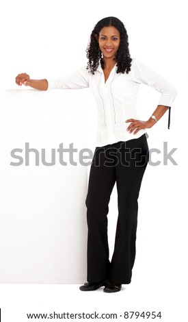 business woman leaning on a banner add isolated over a white background