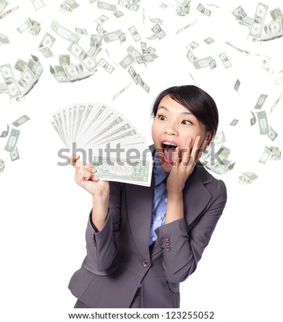 business woman look handful of money with money rain, asian beauty model