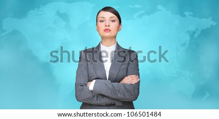 Business woman looking at camera with map on background