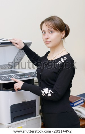 business woman making copies on the photocopy machine