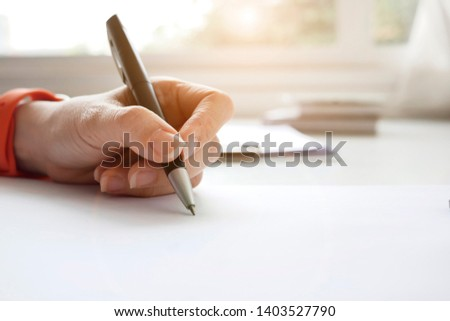 Business woman Manager checking and signing applicant filling documents reports papers company application form or registering claim on desk office.