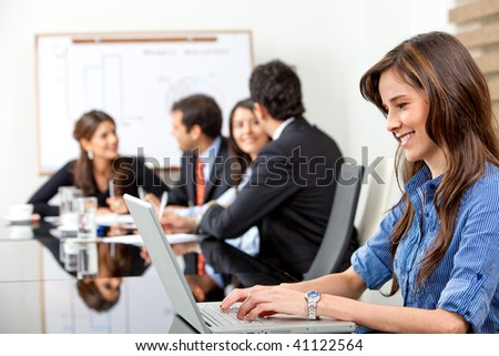 business woman on a laptop in a business meeting