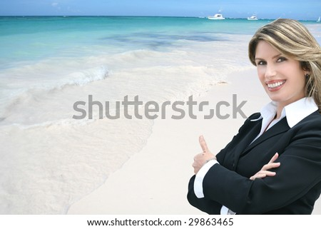 Business woman on a tropical beach giving thumbs up
