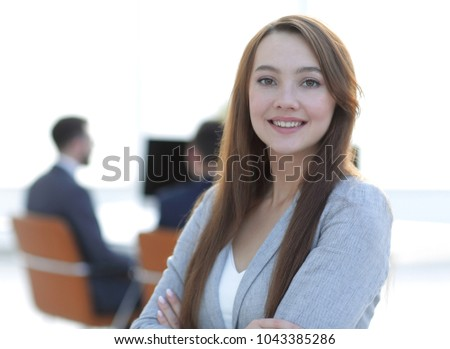 business woman on blurred background office #1043385286