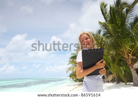 business woman on ocean coast on the background of a palm trees and sky and sea