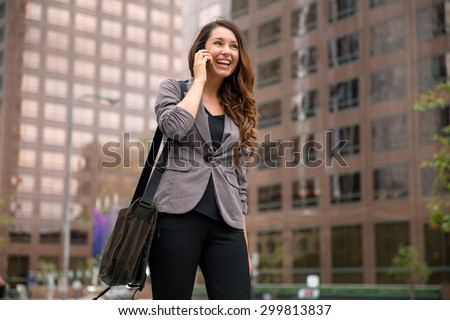 Business woman on way to work young executive successful happy smile walking city