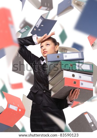Business woman overloaded with a lot of files