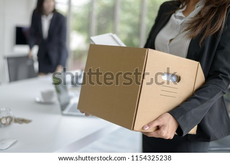 Business woman packing her belonging after resign or be fired from business company  Сток-фото ©