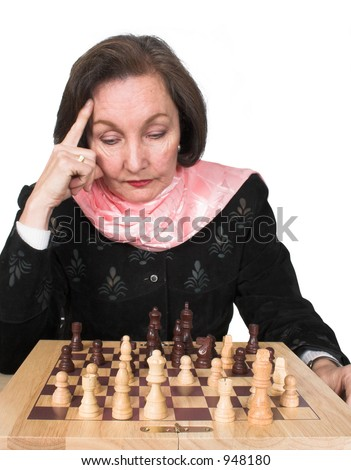 business woman planning her next move on a chess game