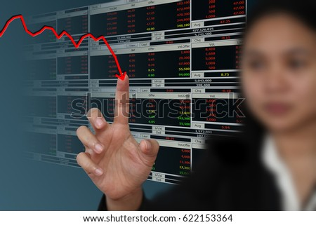 Business woman point to falling graph of stock market #622153364