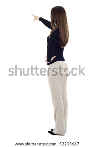 Business woman pointing at something isolated over white background, a lot of copyspace