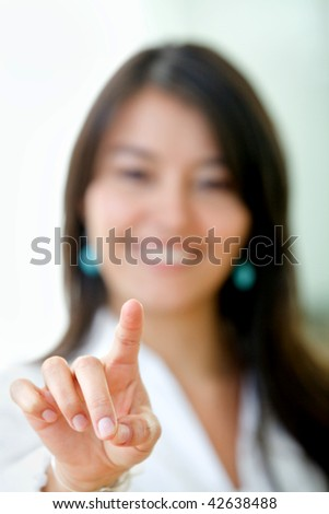 business woman pointing at the screen smiling and isolated over white