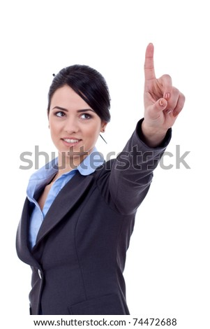 Business woman pointing her finger on imaginery virtual button - stock photo