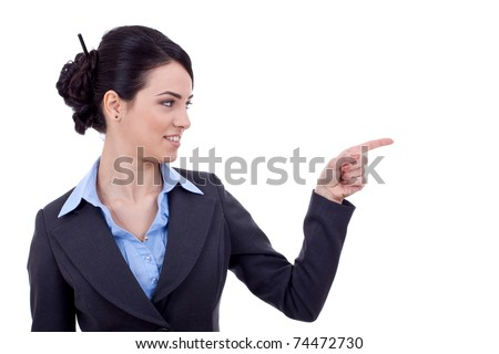 Business woman points finger at something in her left. Isolated on white background