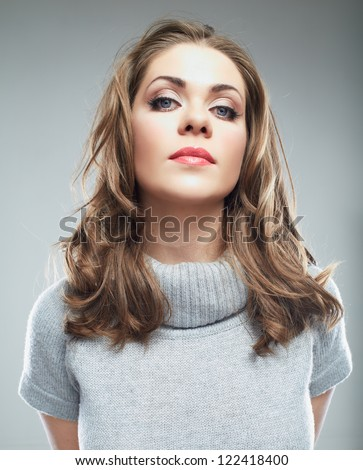 Business woman portrait isolated over gray.
