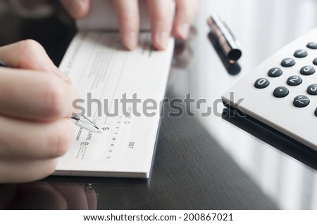 Business woman prepare writing a check #200867021